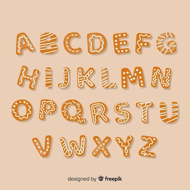 Alphabet en pain d'épice dessiné à la main Vecteur gratuit