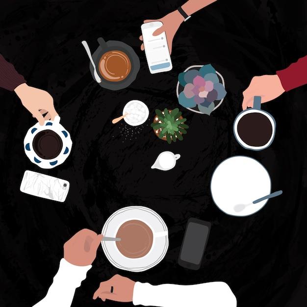 Amis ayant des boissons dans un café Vecteur gratuit