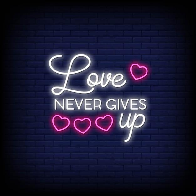 L'amour n'abandonne jamais les enseignes au néon. citation moderne inspiration et motivation dans le style néon Vecteur Premium