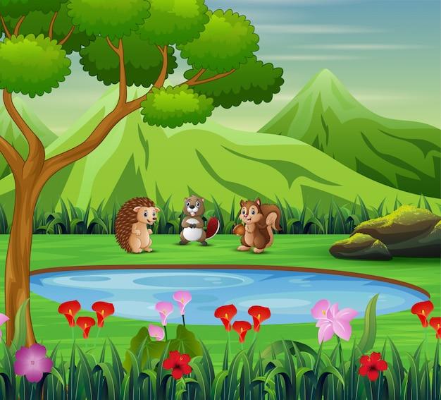Animal dessin animé jouant près du petit étang Vecteur Premium