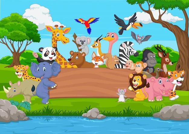 Animal sauvage de dessin animé avec un tableau blanc dans la jungle Vecteur Premium