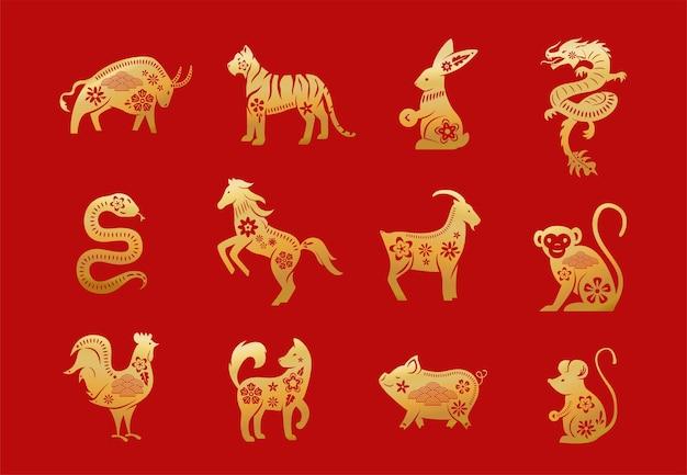 Animaux Du Zodiaque Chinois. Douze Caractères D'or Du Nouvel An Asiatique Mis Isolés Vecteur gratuit