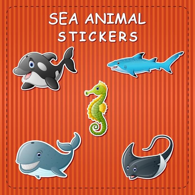 Animaux marins de dessin animé mignon sur l'autocollant Vecteur Premium