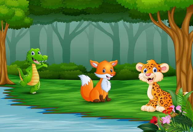 Les animaux sauvages profitent de la nature au bord de la rivière Vecteur Premium