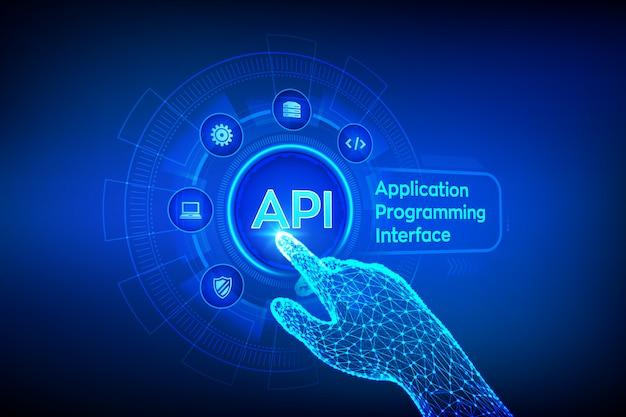 Api. concept d'interface de programmation d'application sur écran virtuel. main robotique touchant une interface numérique. Vecteur Premium