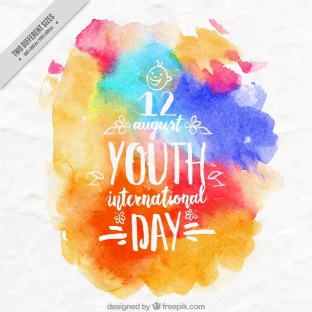 Aquarelle taches colorées jour de la jeunesse de fond Vecteur gratuit