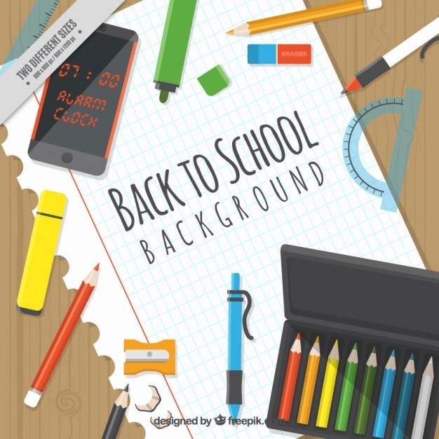 Arri re plan avec des fournitures scolaires sur un for Photo pour arriere plan ordinateur