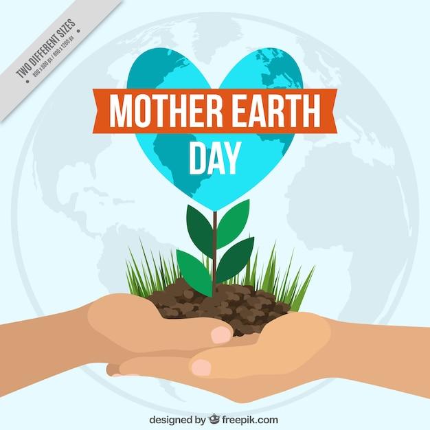 Arrière-plan de la main avec une plante pour la journée terre mère Vecteur gratuit