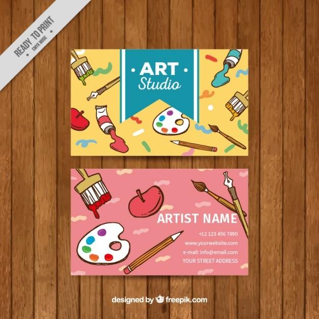 Art carte de studio avec des éléments de la peinture Vecteur gratuit