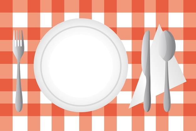 Assiette et couverts sur l'illustration vectorielle de nappe rouge Vecteur Premium