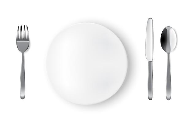 Assiette ou plat blanc réaliste, maquette, fourchette et couteau sur table pour la nourriture Vecteur Premium