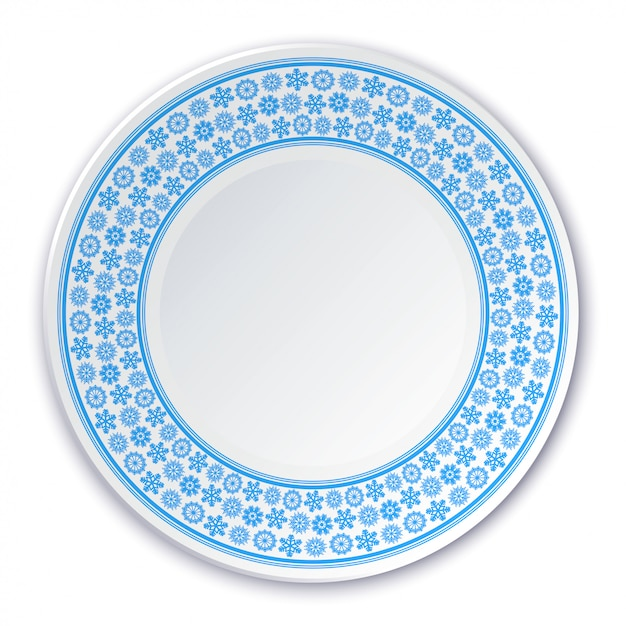 Assiette en porcelaine sur un tableau de flocons de neige bleus sur fond blanc Vecteur Premium