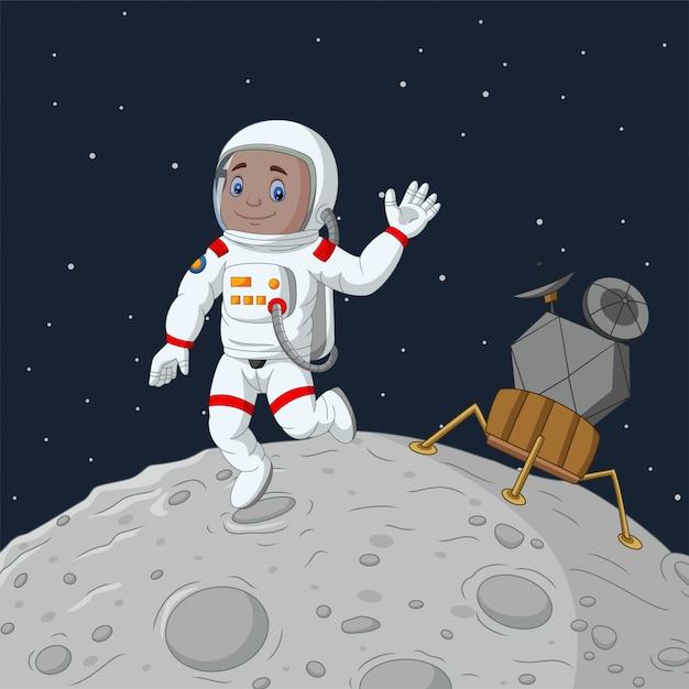 Astronaute cartoon garçon agitant la main Vecteur Premium