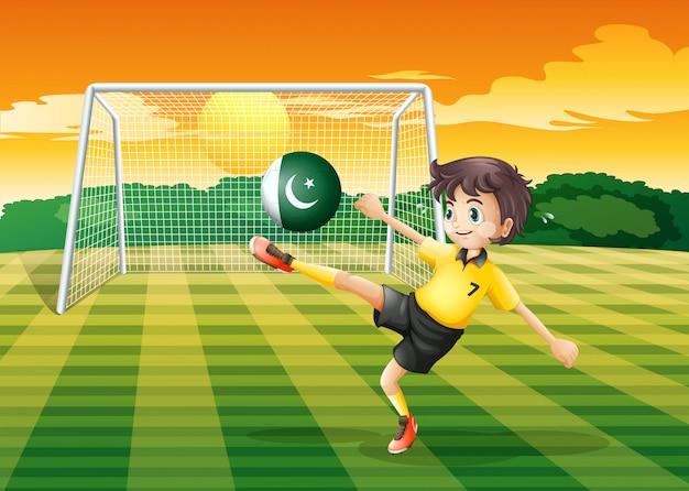 Un Athlète Botter Le Ballon Avec Le Drapeau Du Pakistan Vecteur gratuit