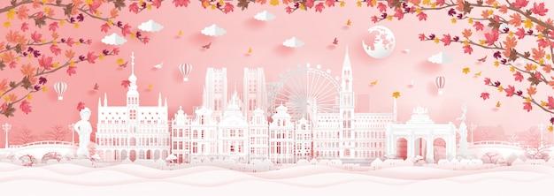 Automne à bruxelles, en belgique avec des feuilles d'érable qui tombent et des monuments célèbres Vecteur Premium