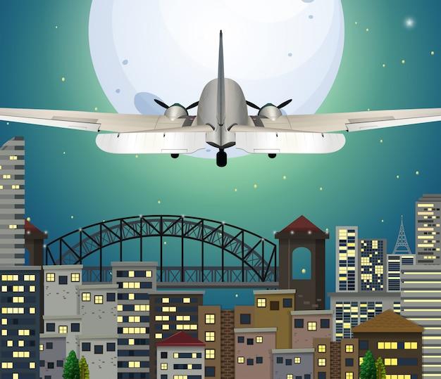Avion survolant la ville urbaine Vecteur Premium