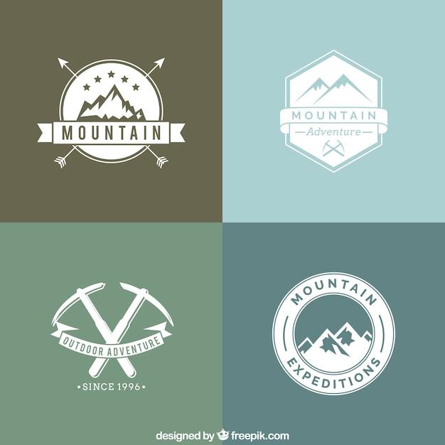Badges D'aventure De Montagne Dans Le Style Rétro Vecteur Premium