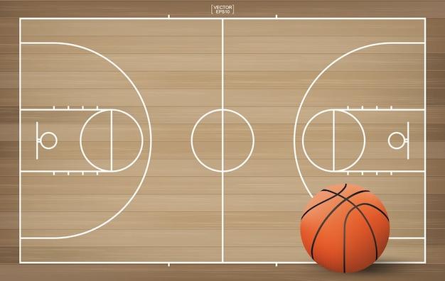 Ballon de basket sur le terrain de basket Vecteur Premium