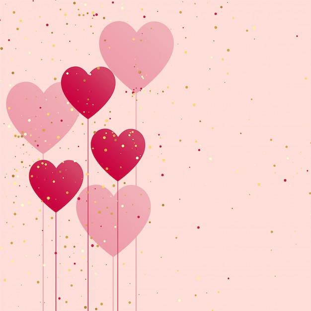 Ballon coeurs avec des confettis dorés Vecteur gratuit