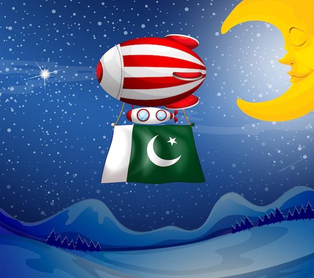 Un ballon flottant avec le drapeau du pakistan Vecteur Premium