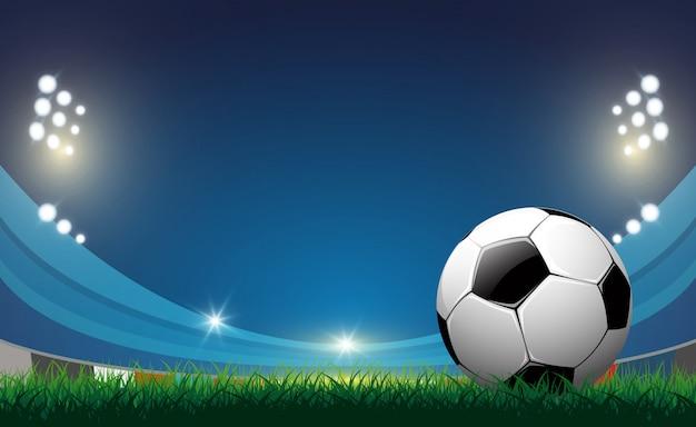 Ballon de foot sur fond d'herbe verte, vector Vecteur Premium