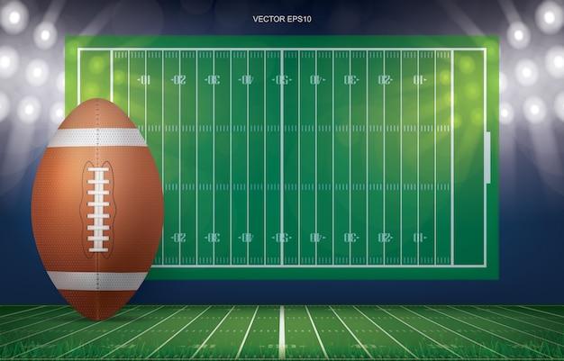 Ballon de football sur fond de stade de terrain de football. Vecteur Premium