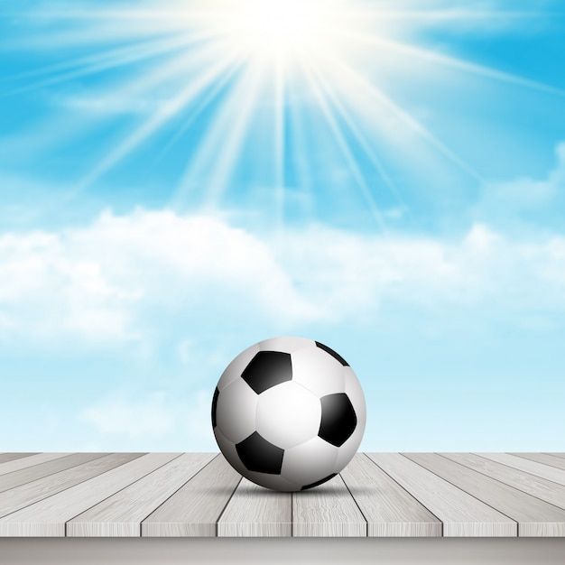 Ballon de football sur la table contre le ciel bleu Vecteur gratuit