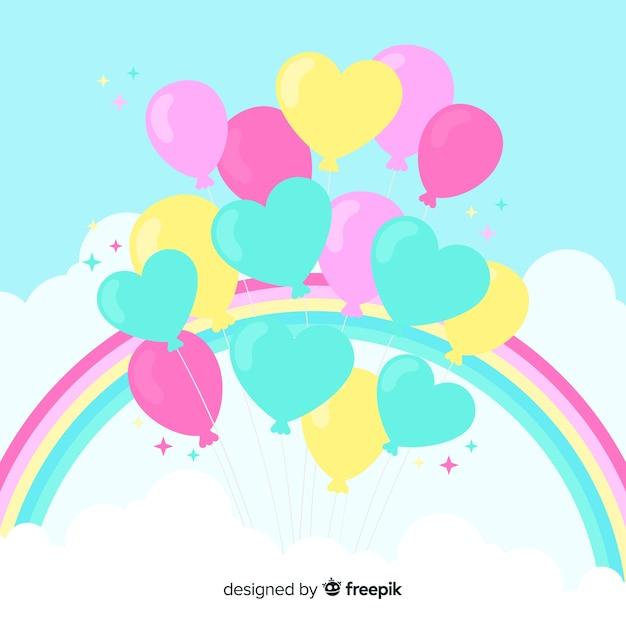 Ballons coeur avec fond arc en ciel Vecteur gratuit