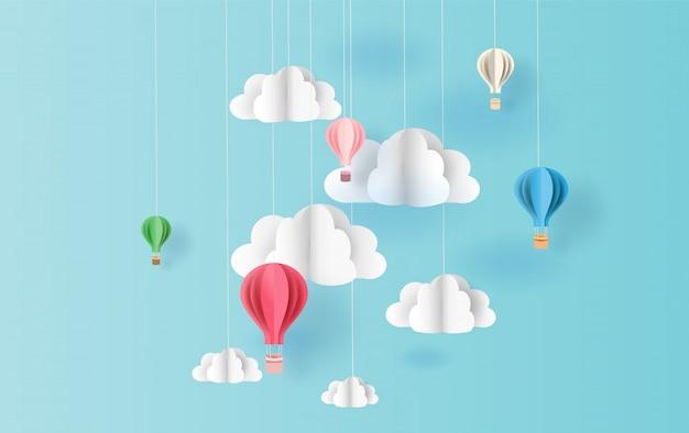 Ballons colorés fond de ciel flottant Vecteur Premium
