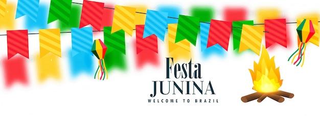 Bannière de célébration festa colorée avec design de feu de joie Vecteur gratuit
