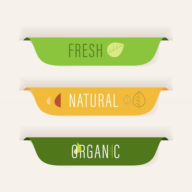 Bannière étiquette naturelle et insigne organique de couleur verte. Vecteur Premium