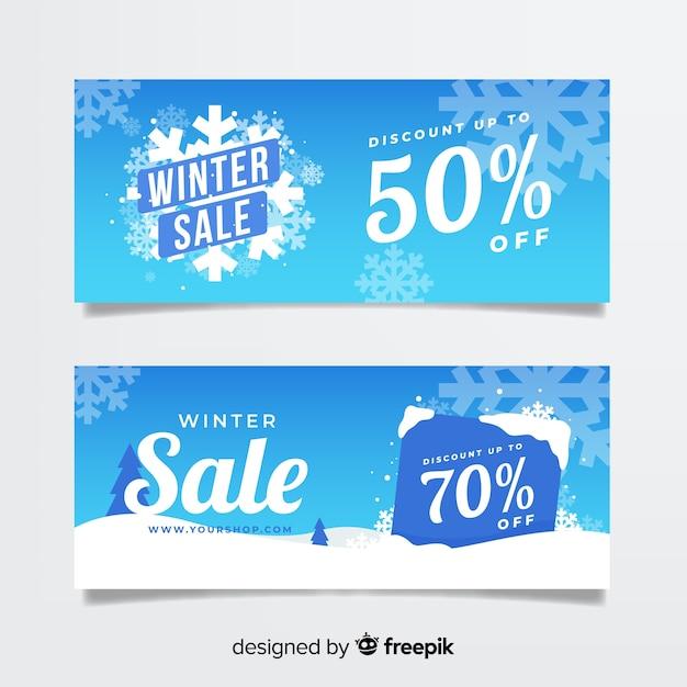 Bannière de flocons de neige de vente d'hiver Vecteur gratuit