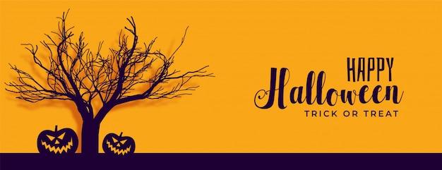 Bannière d'halloween heureux avec arbre effrayant et citrouille Vecteur gratuit