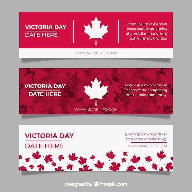 Bannière de jour de victoria avec des feuilles rouges et blanches Vecteur gratuit