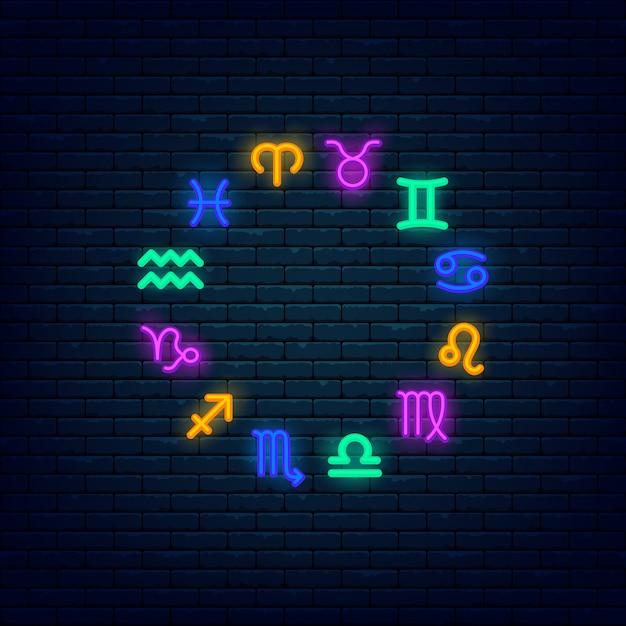 Bannière De Néon Coloré Symboles Zodiac Au Mur De Briques Vecteur Premium