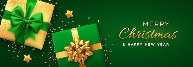 Bannière De Noël Coffrets Cadeaux Réalistes Avec Des étoiles D'or Arc Vert Et Doré Et Des Paillettes Vecteur Premium