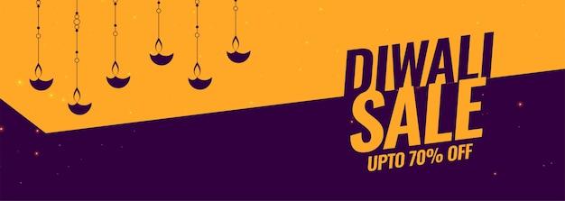 Bannière de vente du festival de diwali avec décoration de lampe diya Vecteur gratuit
