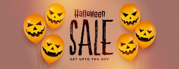 Bannière de vente festival halloween heureux avec des ballons effrayants en riant Vecteur gratuit