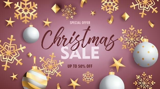 Bannière De Vente De Noël Avec Des Boules Et Des Flocons De Neige Dorés Vecteur gratuit