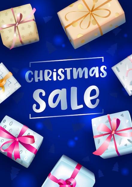 Bannière De Vente De Noël Avec Typographie Et Coffrets Cadeaux Festifs Emballés Sur Fond Flou Bleu Vecteur Premium
