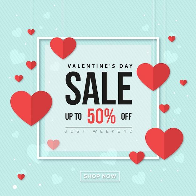 Bannière de vente saint valentin avec coeur sur fond bleu Vecteur Premium