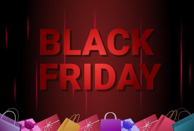 Bannière de vente vendredi noir avec des sacs à provisions sur le concept d'affiche de rabais Vecteur Premium