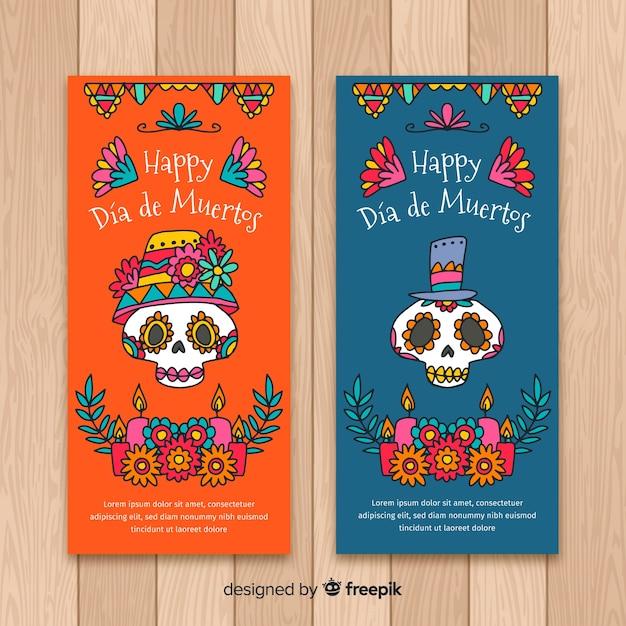 Bannières colorées de día de muertos dessinées à la main Vecteur gratuit