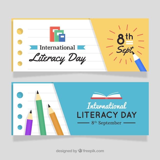 Bannières du jour de l'alphabétisation avec des crayons Vecteur gratuit