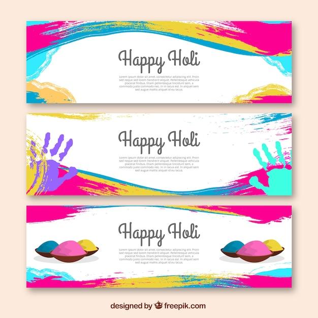 Bannières festival holi avec des taches colorées Vecteur gratuit