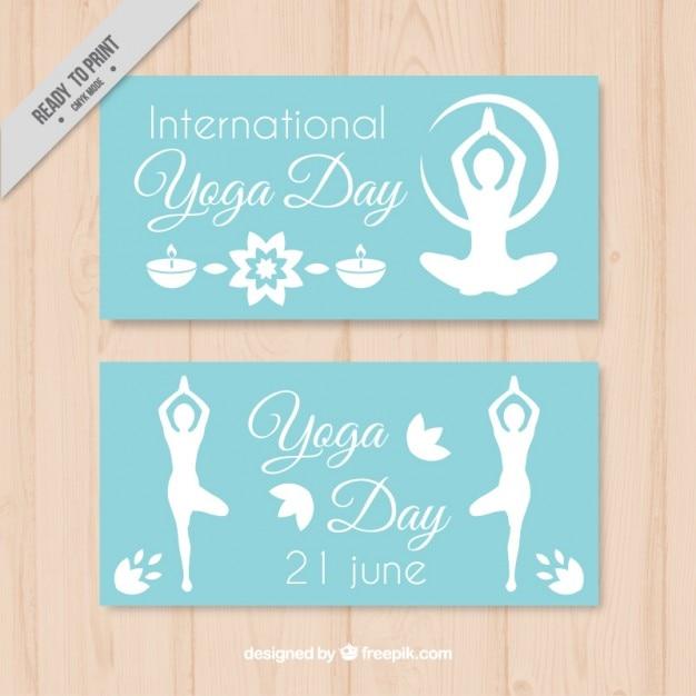 Bannières de la journée de yoga avec des silhouettes Vecteur gratuit