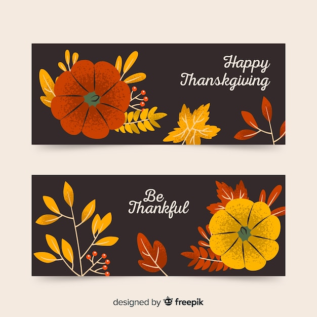 Bannières de thanksgiving dessinés à la main avec des fleurs Vecteur gratuit