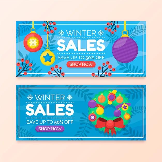 Bannières De Vente D'hiver Plat Avec Guirlande Et Boules De Noël Vecteur gratuit