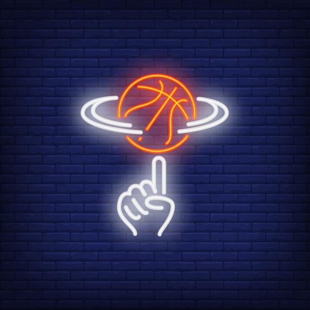 Basketball tournant sur le signe néon de doigt Vecteur gratuit