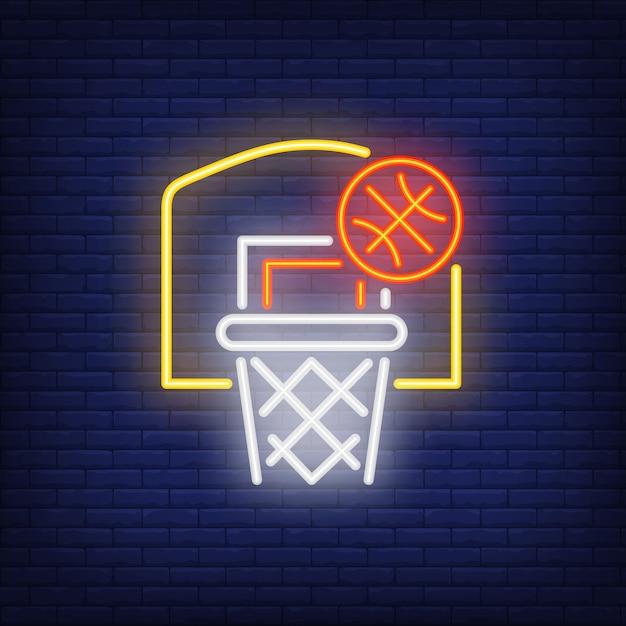 Basketball volant dans le cerceau enseigne au néon Vecteur gratuit